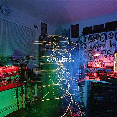 Amulets - Between Distant And Remote
